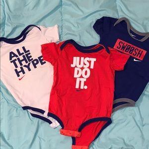 Set of 3 Nike slogan onesies. 9/12 month.